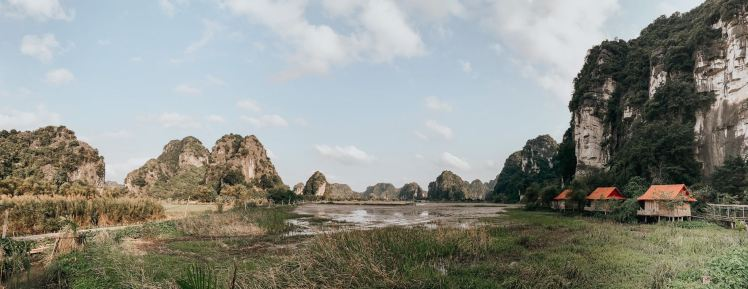 Panoramic view of Lotus Field Homestay in Ninh Binh with mountains, rice fields and private villas