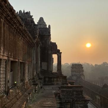 The sun shines over a temple in Cambodia